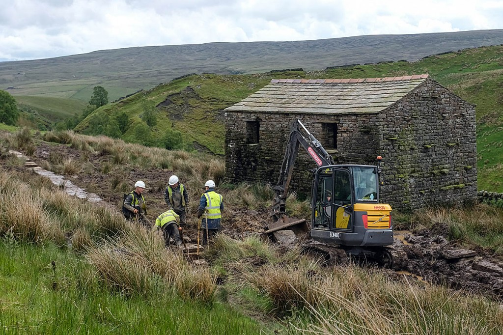 Rangers at work on the route near Ravenseat Farm. Photo: Yorkshire Dales NPA