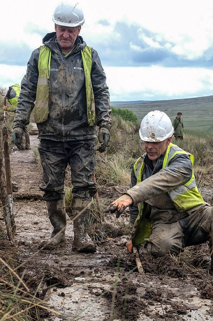 Access rangers Paul Sheehan and Roger Foreman lay flags at the site. Photo: Yorkshire Dales NPA