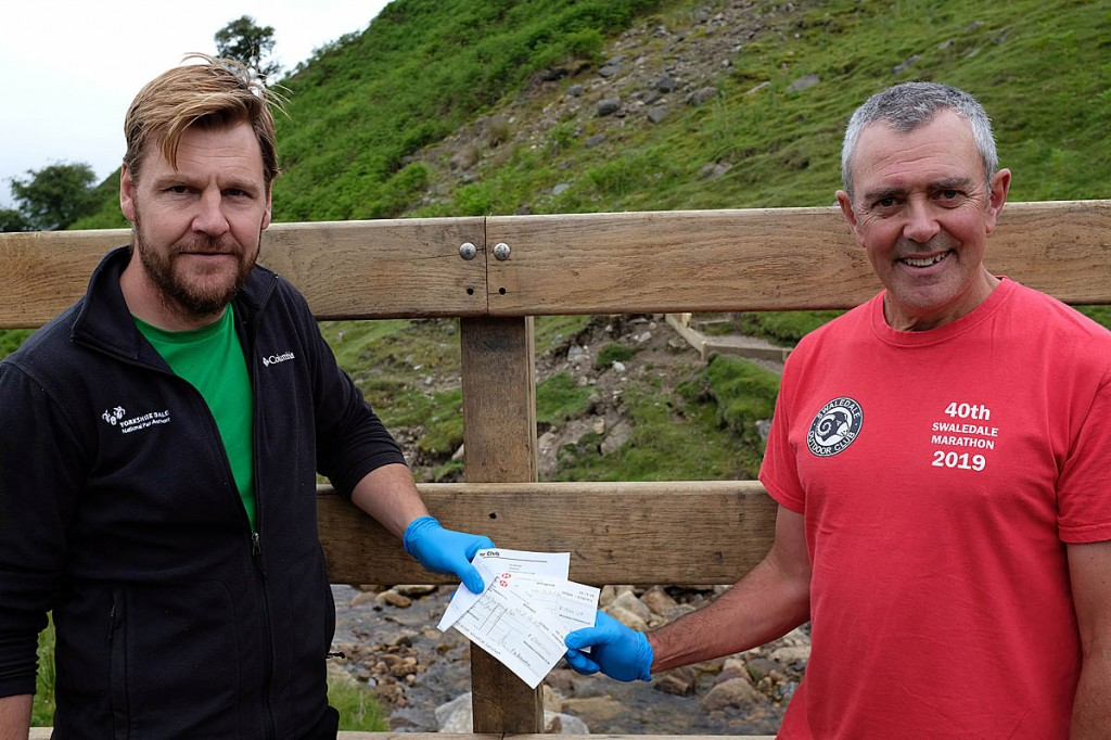 Michael Briggs receives cheques from Tim Blenkin
