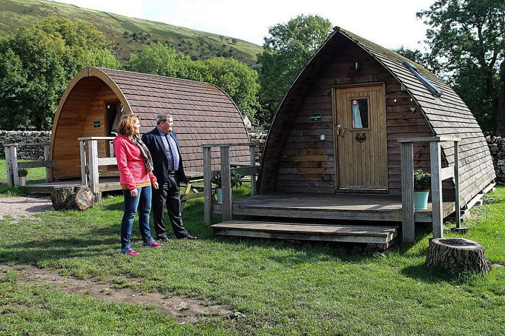 Gill Schofield and Carl Lis look at the camping pods at Heber Farm