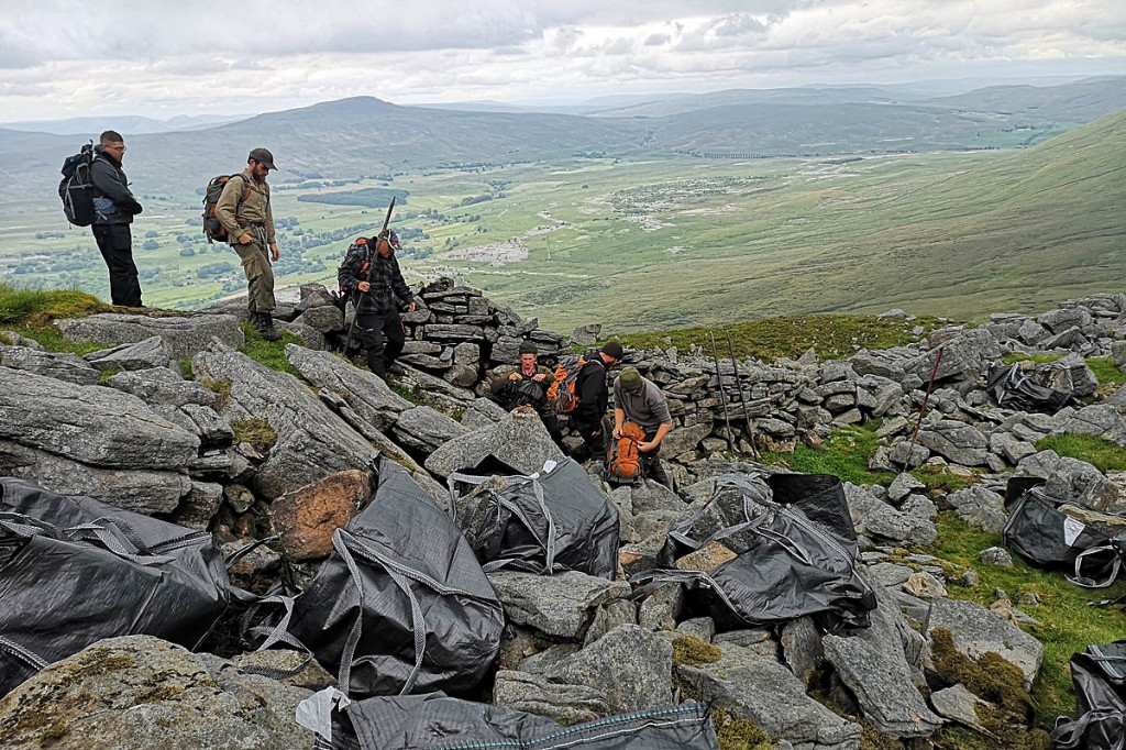 Gritstone blocks from a nearby scree slope have been picked and bagged. Photo: YDNPA