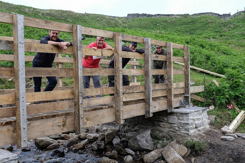 The new bridge with, from left, Michael Briggs, Tim Blenkin, access ranger Roger Foreman and Dales Volunteer David Fox