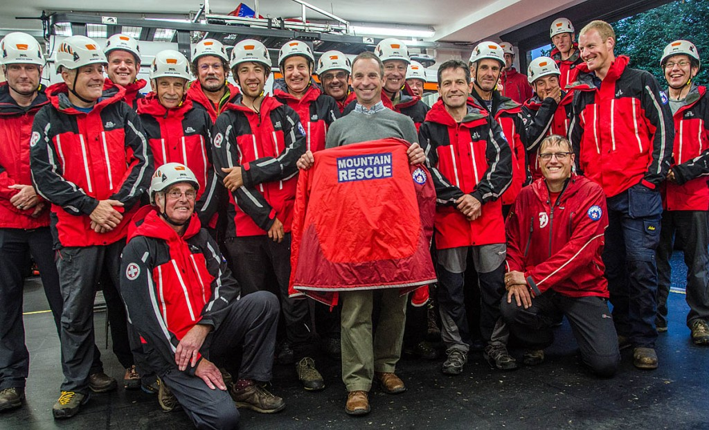 Mark Allum, centre, holds one of the new jackets, surrounded by members of the Upper Wharfedale Fell Rescue Association. Photo: Sara Spillet