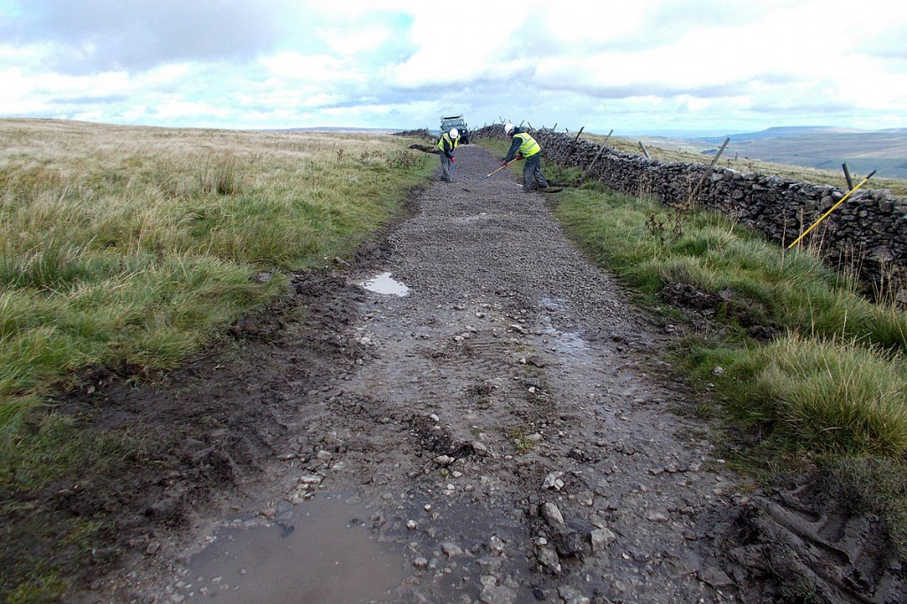 Work in progress to resurface Cam High Road, with Addleborough in the distance. Photo: Yorkshire Dales NPA