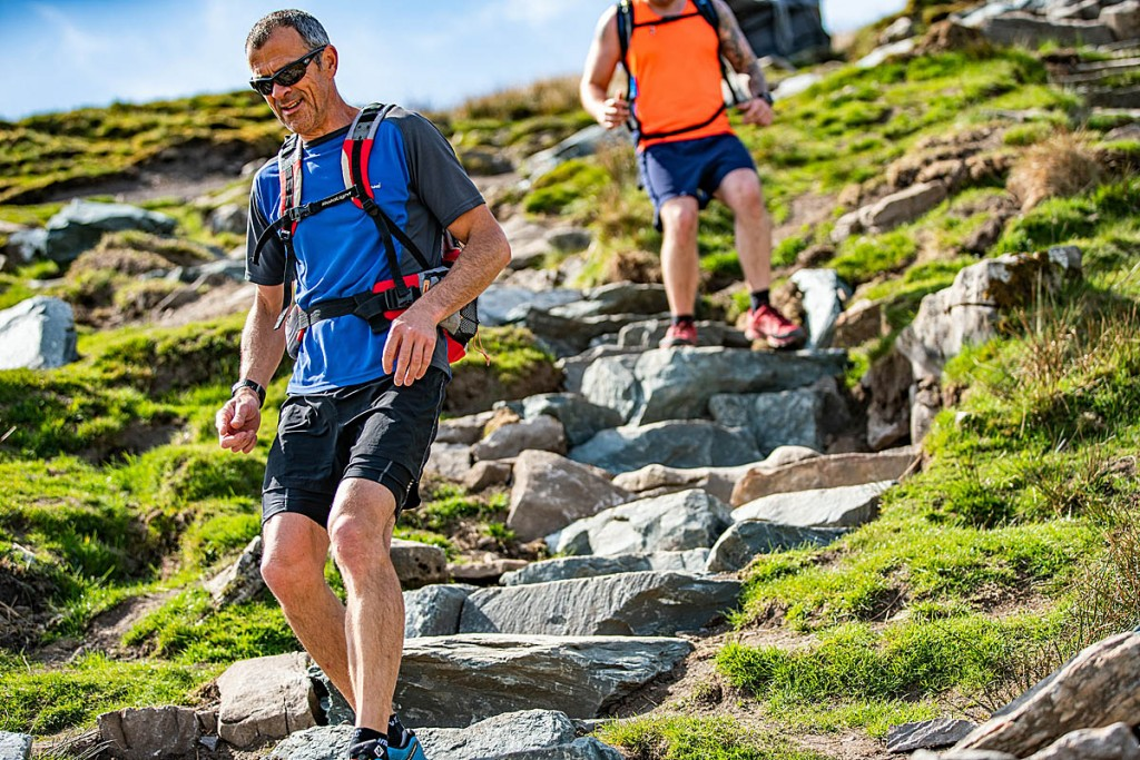 Walkers descend the path towards Bruntscar on Whernside. Photo: Andy Kay/Yorkshire Dales NPA