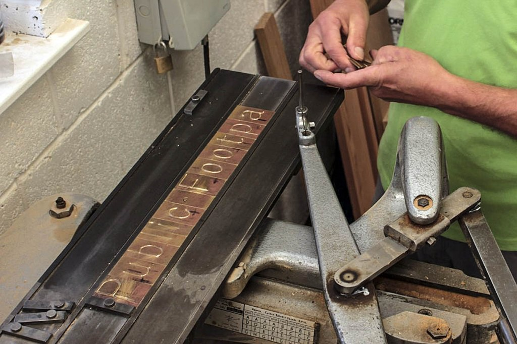 The brass blanks are loaded into the machine. Photo: Andrew Fagg/YDNPA
