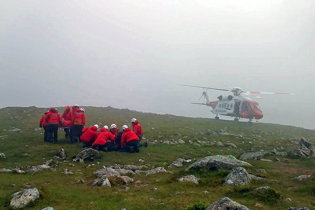 Rescuers and the Coastguard helicopter at the scene. Photo: Aberdyfi SRT