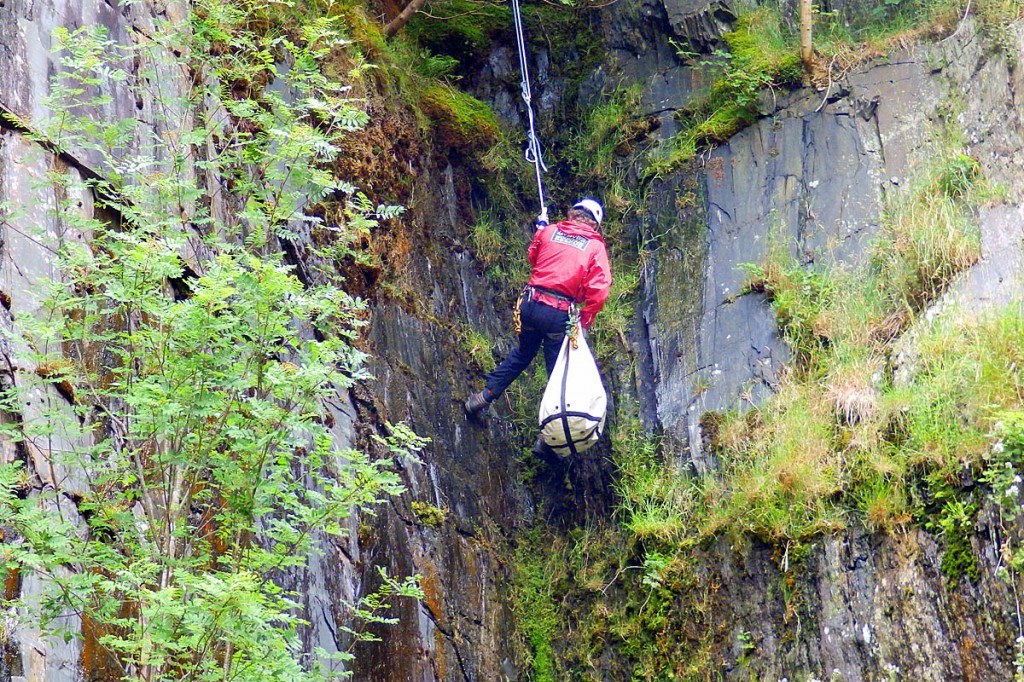 Mac and rescuer Paul Aslin are lowered down to the quarry floor. Photo: Aberdyfi SRT
