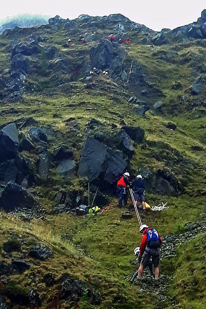Team members bring the cragfast group to safety. Photo: Aberdyfi SRT