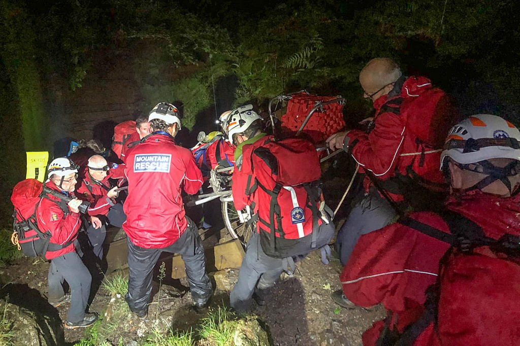 Rescue team members stretcher the man down the Minffordd steps. Photo: Aberdyfi SRT