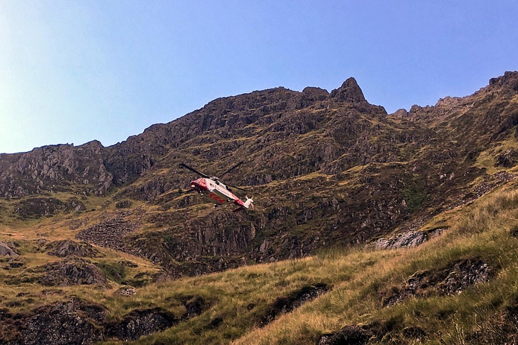 The Caernarfon Coastguard helicopter in Cwm Cau during the rescue. Photo: Aberdyfi SRT