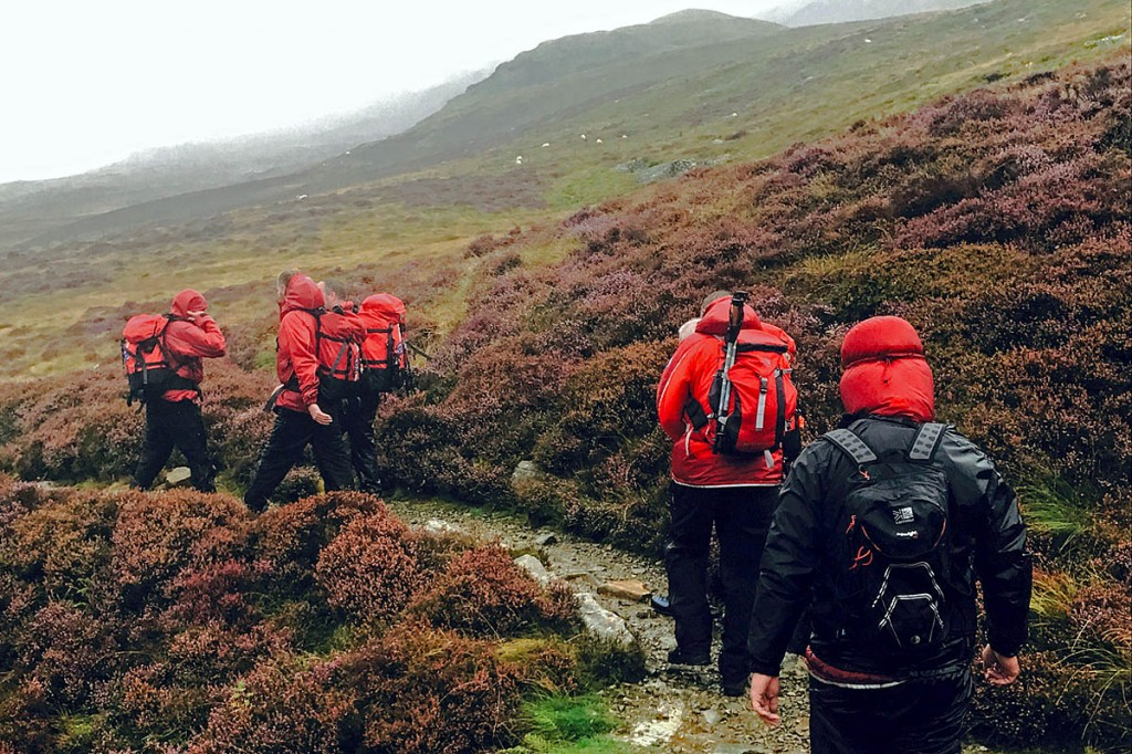 The rescue party makes its way off the mountain. Photo: Aberdyfi SRT