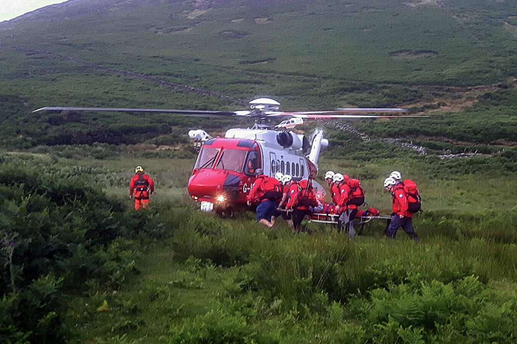 Rescue team members stretcher the walker to the Coastguard helicopter. Photo: Aberdyfi SRT
