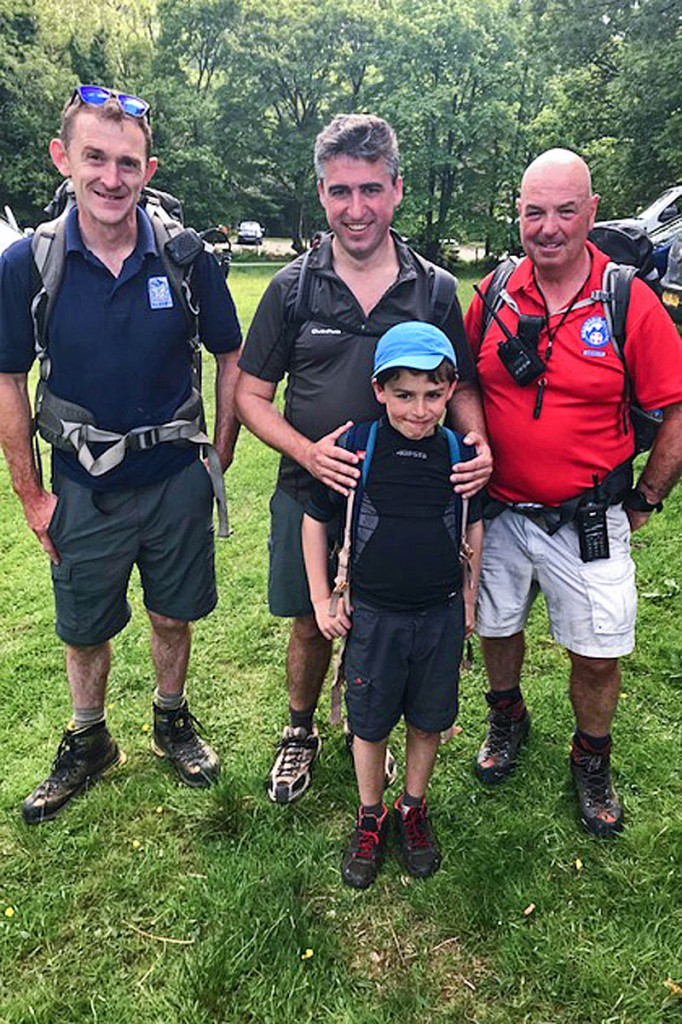 Father and son with Snowdonia national park ranger Gethin Corps, left, and Aberdyfi team volunteer Geoff Brittain. Photo: Aberdyfi SRT