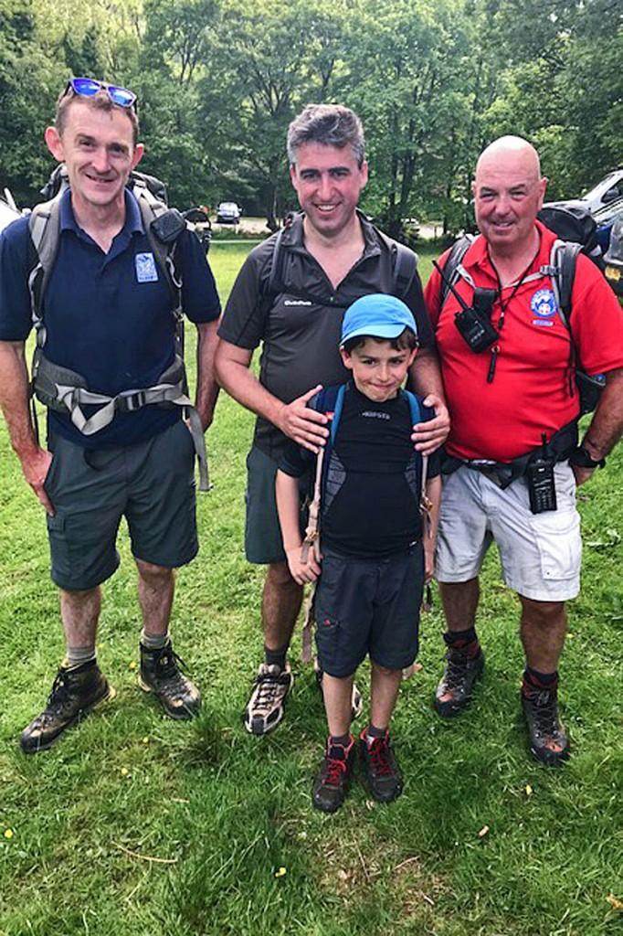 Father and son with Snowdonia national park ranger Gethin Corps, left, and Aberdyfi team volunteer Geoff Brittain. Photo: Aberdyfi SRT