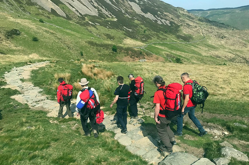 The injured walker is escorted down the Minffordd path. Photo: Aberdyfi SRT