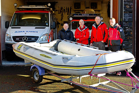 The Aberglaslyn team takes delivery of the boat from Keswick colleagues