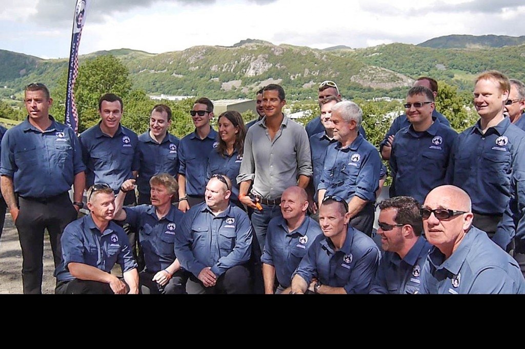 Bear Grylls lines up with members of the Aberglaslyn team at the official opening of their new HQ. Photo: Aberglaslyn MRT