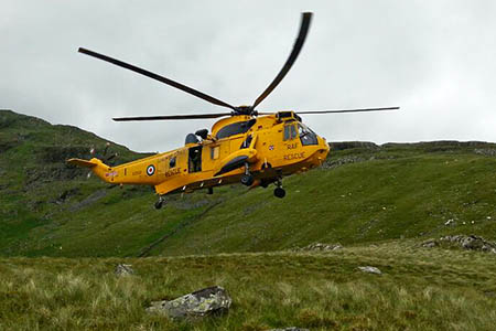A Sea King helicopter from RAF Valley at the rescue scene on Yr Arddu. Photo: Aberglaslyn MRT