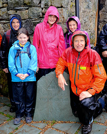 Alan Hinkes and primary school children at the reopening of Black Sail youth hostel