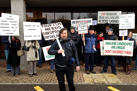 Chris Townsend, centre, leads a demo outside the Highland Council offices