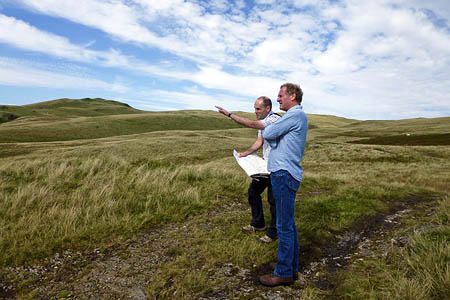 Former Poet Laureate Sir Andrew Motion Richard Pearse of the Friends of the Lake District looking across the Lune Valley at sites where windfarms are threatened