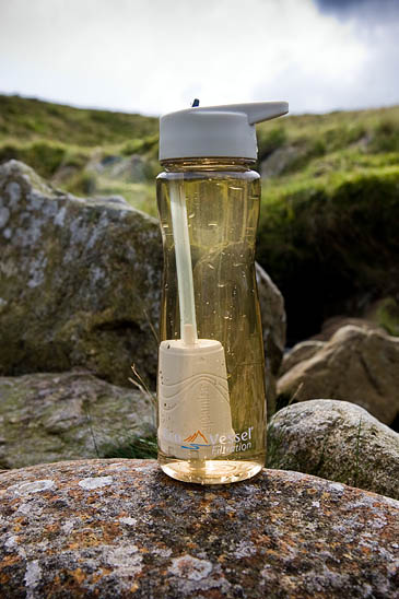 The Eco Vessel Aqua Vessel Ultra Lite filled with murky stream water