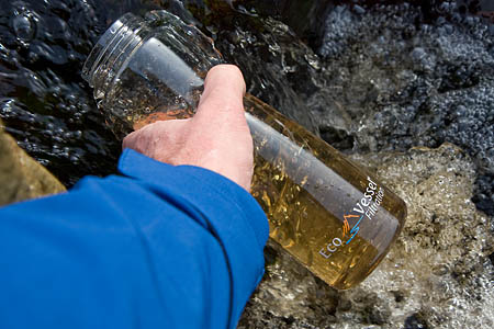The bottle is filled with water from a Yorkshire Dales stream