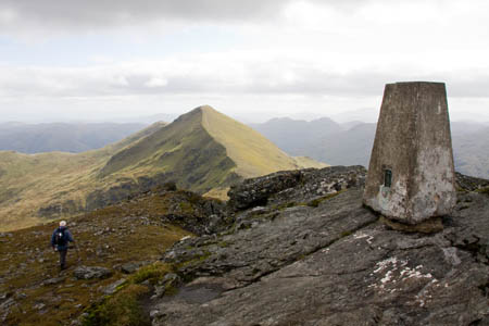 The summit of Ben More, looking towards Stob Binnein. Ben Lomond can be seen in the far distance