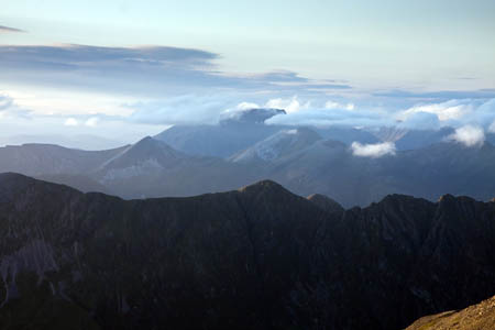 Ben Nevis and the Mamores are visible from the route, with Aonach Eagach in the foreground
