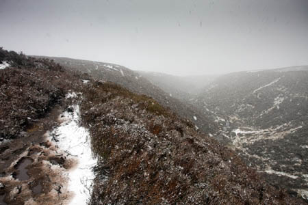 A sudden snowstorm blankets Black Clough: a sign that the hill's weather can change in minutes