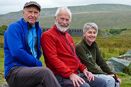 Alan Hinkes, left, Sir Chris Bonington and Kathryn Beardmore at Ribblehead, with Whernside in the background. Photo: Yorkshire Dales National Park Authority