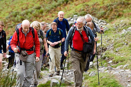 Sir Chris Bonington strides out with a group in the Lake District
