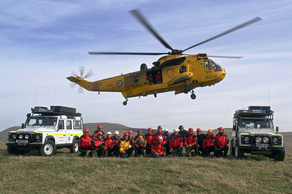Border Search and Rescue Unit members are joined by colleagues in an RAF Sea King