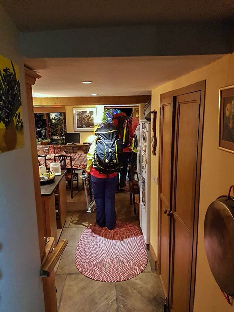 The Brecon MRT stretcher team makes its way through the Old Crofftau kitchen. Photo: Brecon MRT