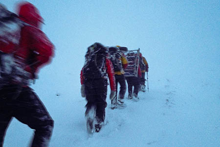 Rescuers make their way to the brothers through a blizzard