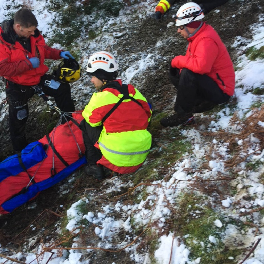 Rescuers with one of the injured off-roaders. Photo: Brecon MRT
