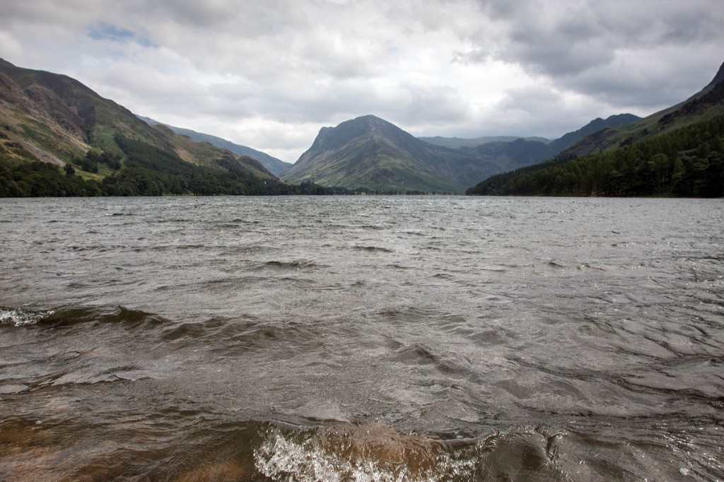The woman was walking on the Buttermere shore path