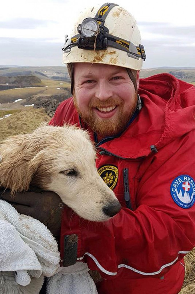 The golden retriever with her rescuer. Photo: Buxton MRT