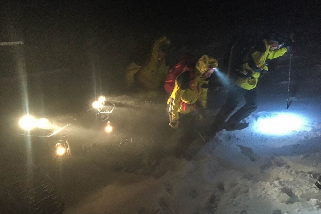 Rescue team members with the tracked vehicle used in the incident. Photo: Cairngorm MRT