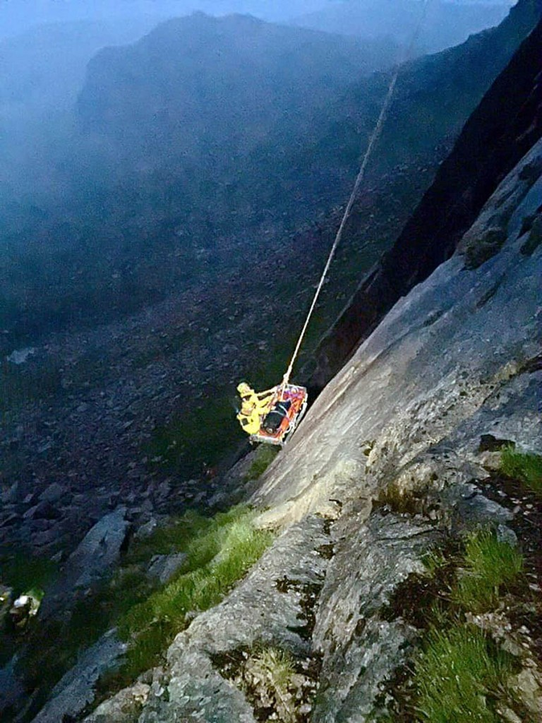 The injured climber is lowered down Shelter Stone Crag. Photo: Cairngorm MRT