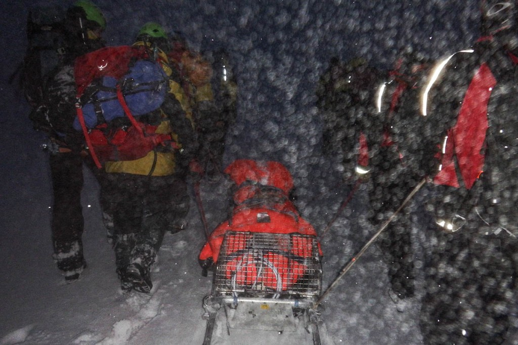 The injured climber is stretchered from the corrie. Photo: Cairngorm MRT
