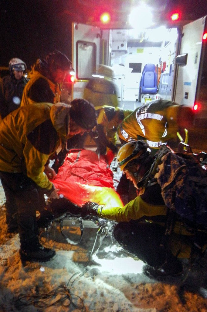 The injured climber was stretchered to a waiting ambulance. Photo: Cairngorm MRT