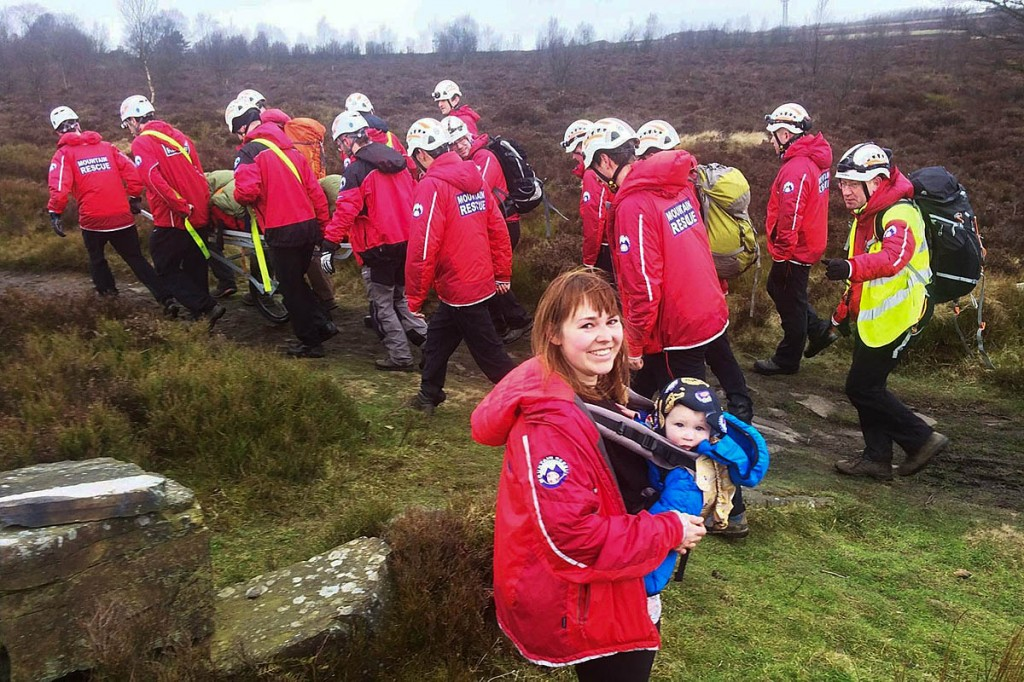 The injured man is stretchered from the moor by rescuers as Sophie Keeler and Jesse look on. Photo: Calder Valley SRT