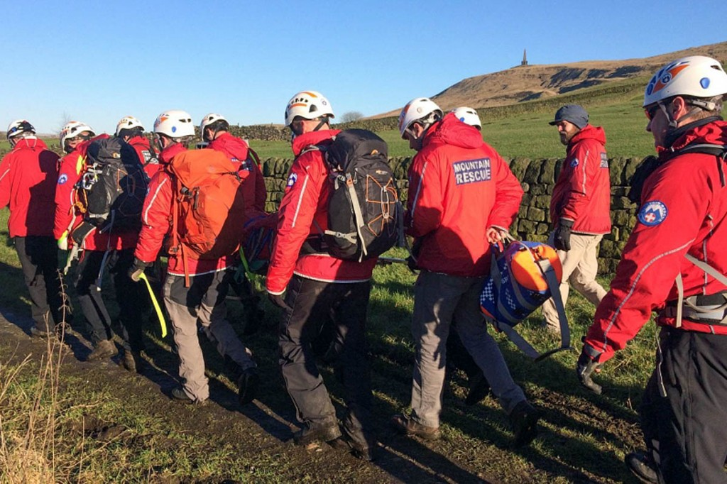 Rescuers stretcher the injured walker from the site near Stoodley Pike. Photo: Calder Valley SRT