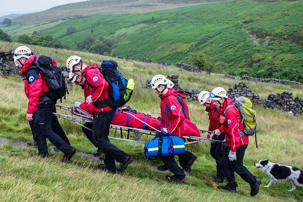 Rescuers stretcher the injured woman to the waiting helicopter. Photo: Calder Valley SRT