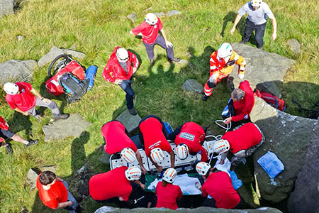 Members of Calder Valley Search and Rescue Team treat the injured climber at Earl Crag, Cowling. Photo: Calder Valley SRT