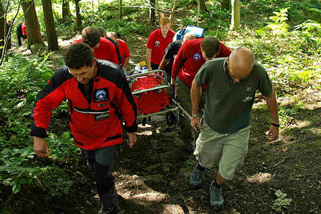 Rescuers stretcher the woman from the incident site. Photo: Calder Valley Search and Rescue Team