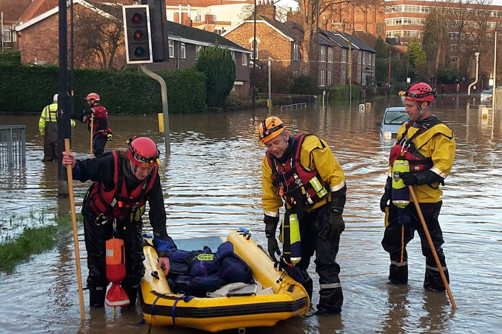 Members of the Clapham, North Yorkshire-based Cave Rescue Organisation join in the York flood operation. Photo: CRO