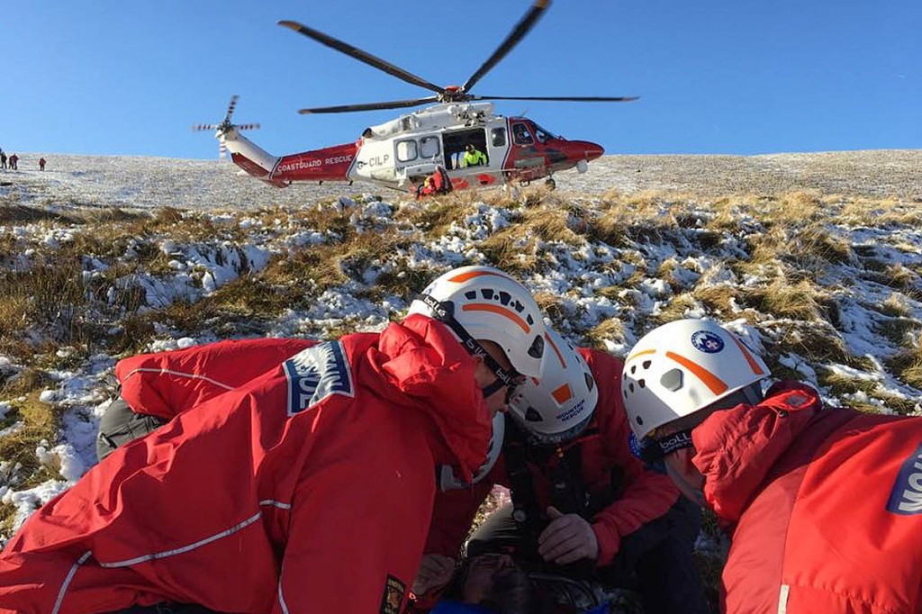 Rescuers with the Coastguard helicopter on Pen y Fan. Photo: Central Beacons MRT